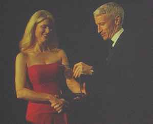 Anderson Cooper presenting Heather Bosch with a national Edward R. Murrow Award