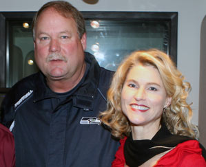 Heather Bosch with Mike Holmgren at KIRO Radio studios in Seattle when Holmgren was the Seahawks' coach -- between 1999 to 2008.