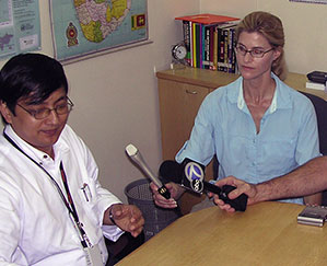 Heather Bosch interviewing the executive of World Vision while covering the tsunami aftermath in Sri Lanka