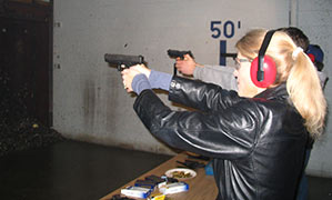 Heather Bosch fires a gun for the first time as part of her series Taking Up Arms