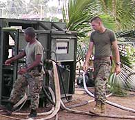 S Marines help tsunami victims recover by setting up a water cleaning machine